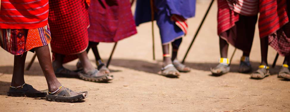 A group of African people with a close up of their feet