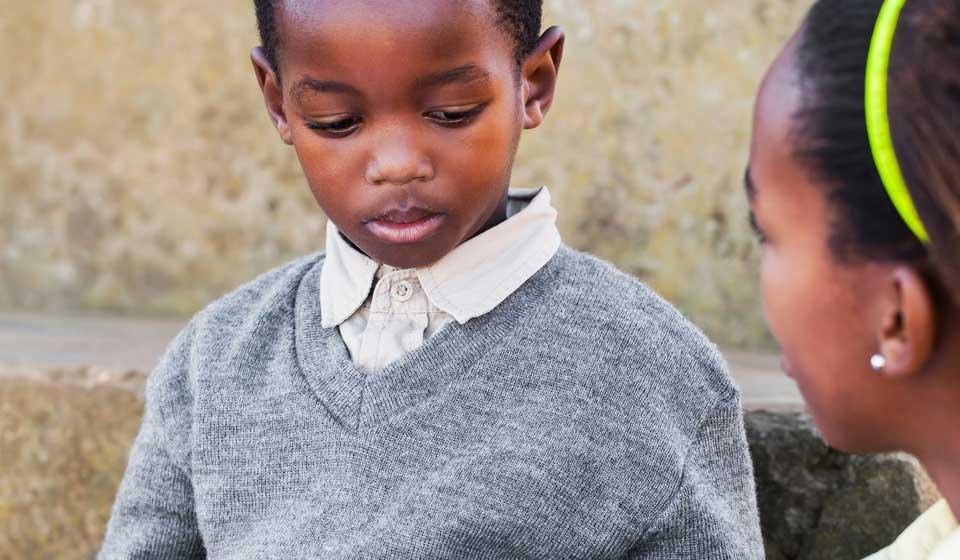 Two African schoolchildren learning