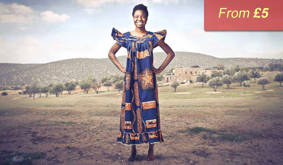 An African lady standing smiling