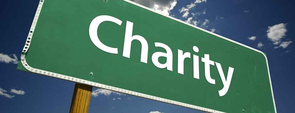 The word charity is written on a signpost