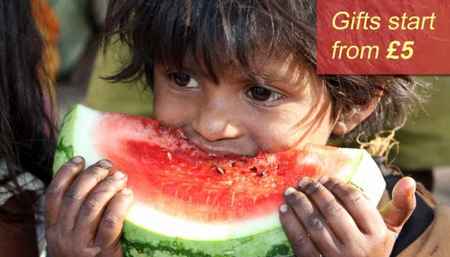 A child eating watermelon