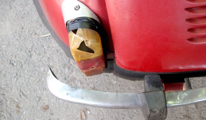 A rear light on a card is smashed