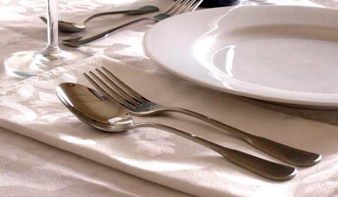 A dinner table set with plate and cutlery