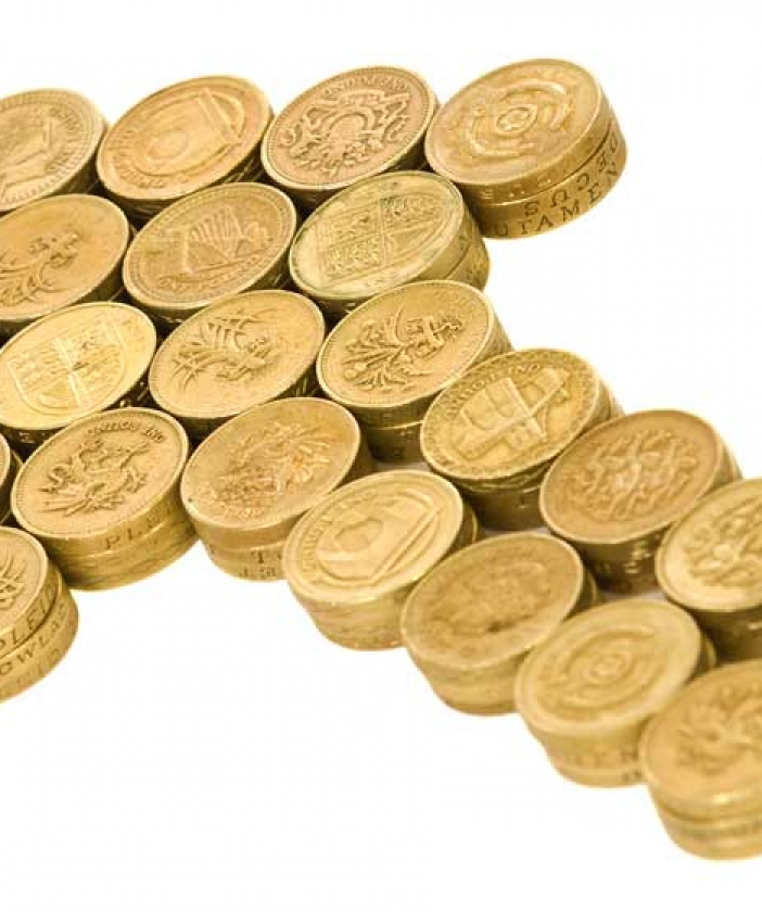 An arrow made from pound coins