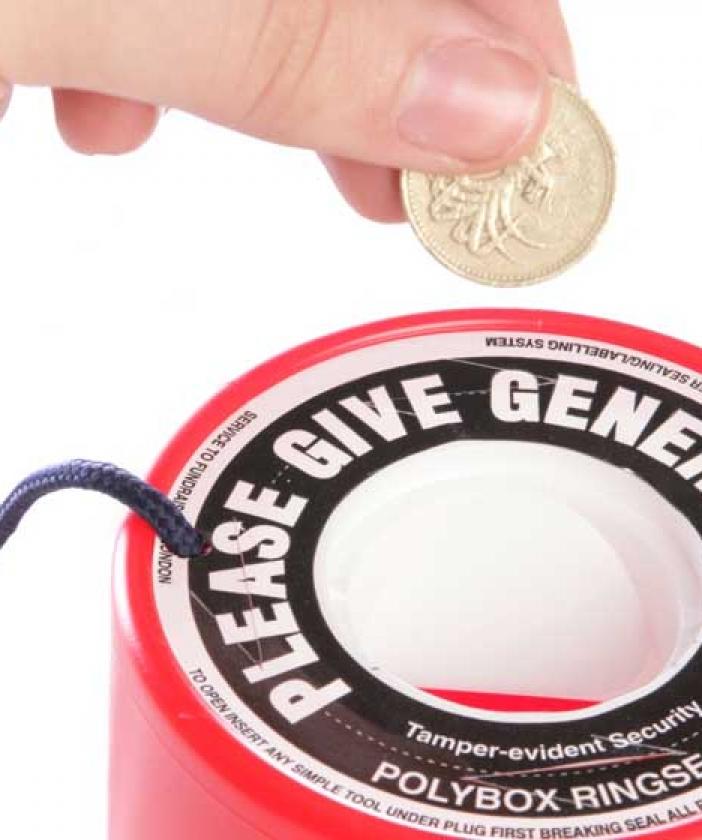 Pound coin into collection tin